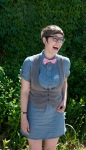 laughing girl in pink bow tie