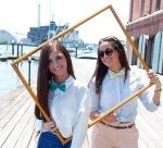 Girls wearing bow ties, in frame