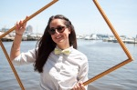 Preppy girl in bow tie with picture frame