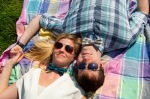 Couple on picnic blanket, wearing bow ties