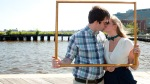 Kissing couple in frame, bow ties