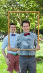 Boys in bow ties in picture frame