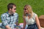 Couple having a picnic, bow ties