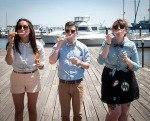 trio in bow ties blowing bubbles