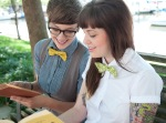 Girls in bow ties, reading